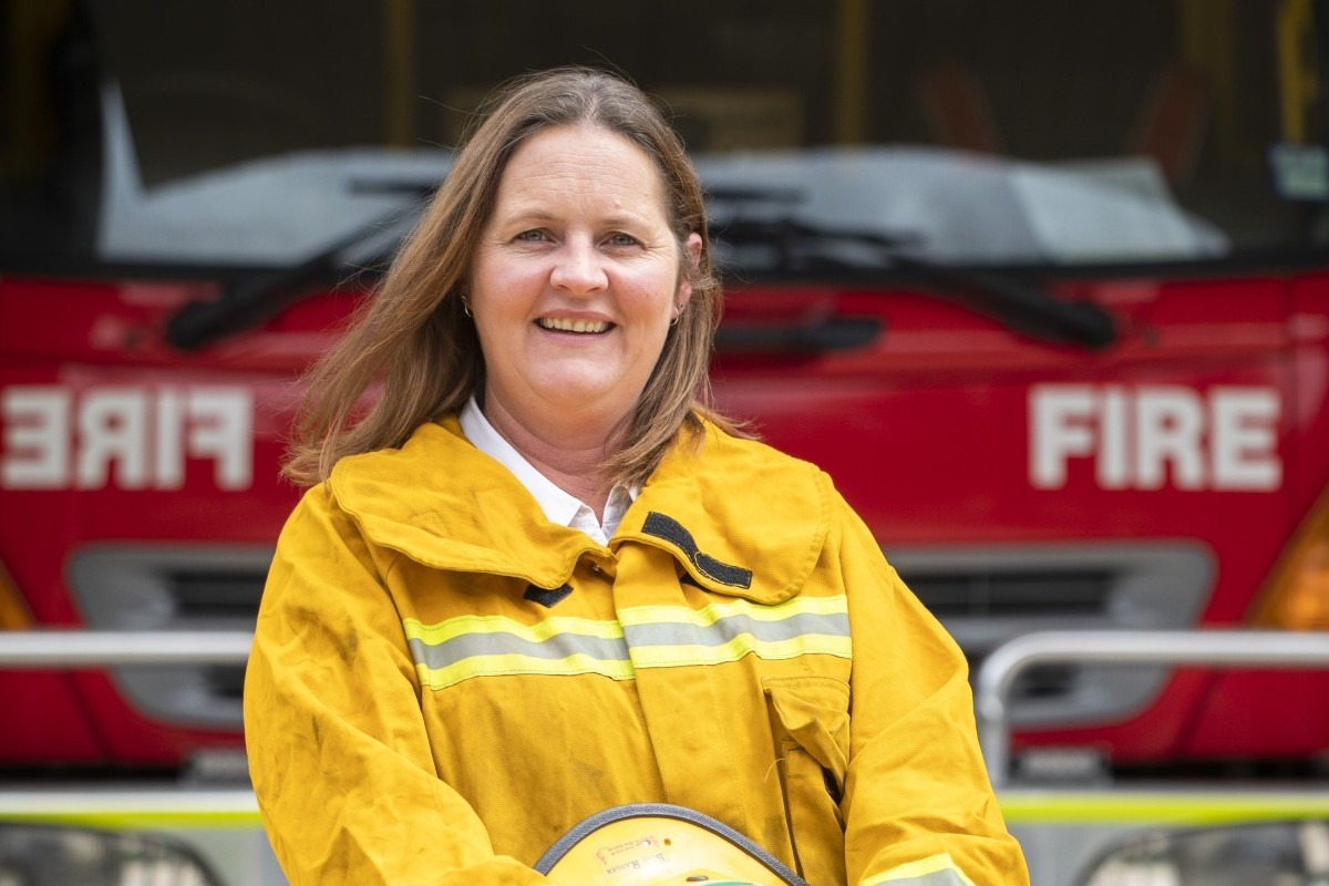 Tammy Meyers standing in front of a CFA firetruck